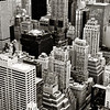 <h2>Flight - The New York City Skyline From Above</h2> - By Vivienne Gucwa  Driven by an imagination stirred by visions Batman flying through Gotham, I used to have vivid dreams when I was younger of flying through the skyscrapers that are part of the midtown Manhattan skyline.   This cluster of skyscrapers is one of my favorites. These buildings seem to huddle together in a solemn solidarity: titans comprised of multitudes of urban aspirations.  ---