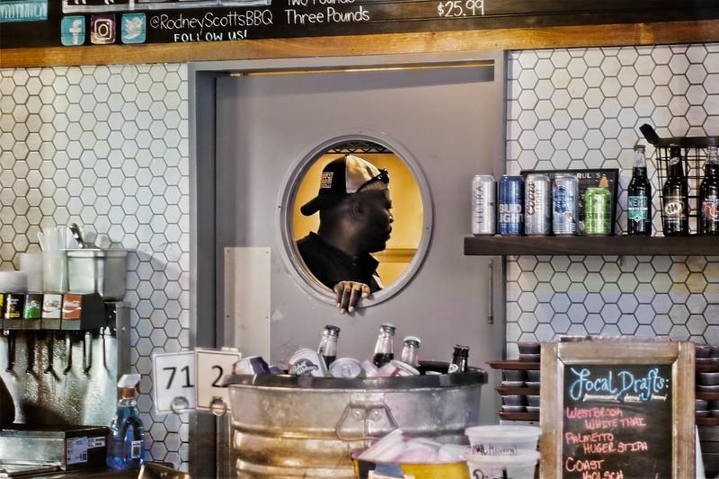 BBQ pitmaster Rodney Scott oversees his kitchen in Charleston.<br />  Photo © Cindy Clark