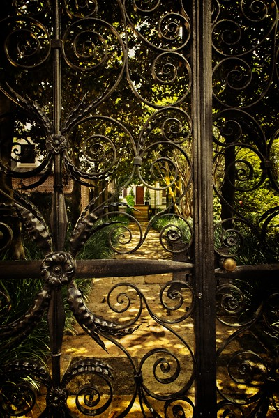 Most of Charleston's wrought iron balconies were melted down for use in the Civil War. They did, however, keep their gates and fences.<br /> Photo © Cindy Clark