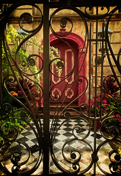 Lovely wrought iron gate in Charleston.<br /> Photo © Cindy Clark