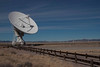 One of the radio telescopes collecting electromagnetic radio waves at the Very Large Array.<br /> Photo © Carl Clark