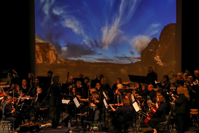Conductor/composer Gary Gackstatter leads the Gallup Community College Orchestra and guest soloist R. Carlos Nakai in the Chaco Symphony - A Journey of the Spirit.<br /> Photo © Cindy Clark