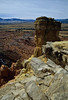 Looking over Chimney Rock to the desert expanse at Ghost Ranch.<br /> Photo © Carl Clark