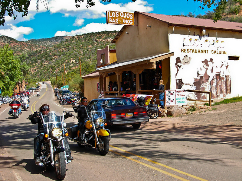Motorcycles liven the scene around Los Ojos Bar in Jemez Springs.<br /> Photo © Carl Clark
