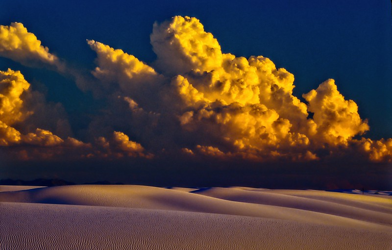 Drama as a storm builds at sunset at White Sands.<br /> Photo © Cindy Clark
