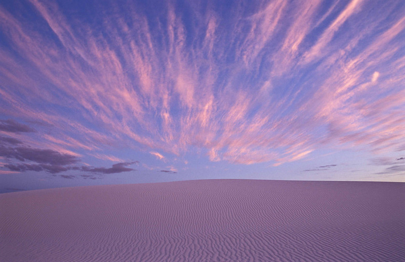 Sand and clouds converge at the end of the day at White Sands.<br /> Photo © Carl Clark