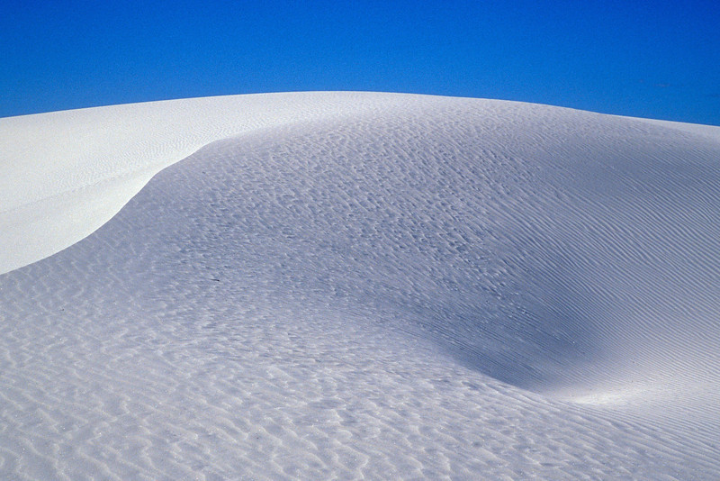 White Sands' dunes are made of gypsum, which absorbs rather than reflects light.<br /> Photo © Cindy Clark