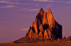 Formed by a violent gas-driven eruption called a mantle blowout, Ship Rock glows with the setting sun.  <br /> Photo © Cindy Clark