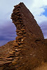A partial wall at Chaco Canyon contrasted against a gathering storm.<br /> Photo © Cindy Clark