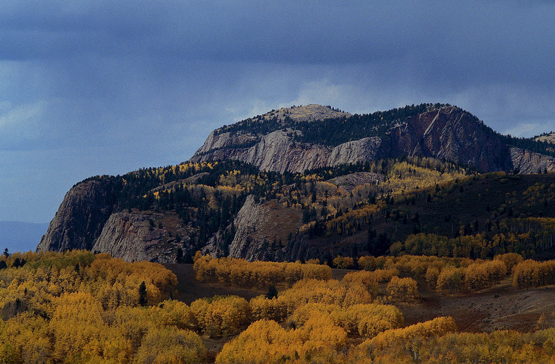 The Brazos Cliffs provide a dramatic backdrop to aspens.<br /> Photo © Cindy Clark
