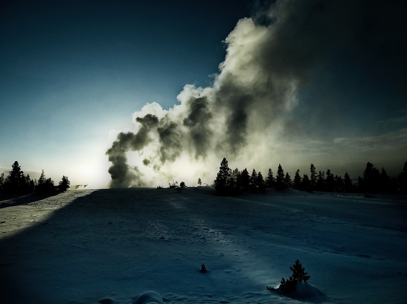 Backlit geyser at Yellowstone National Park.<br /> Photo © Cindy Clark