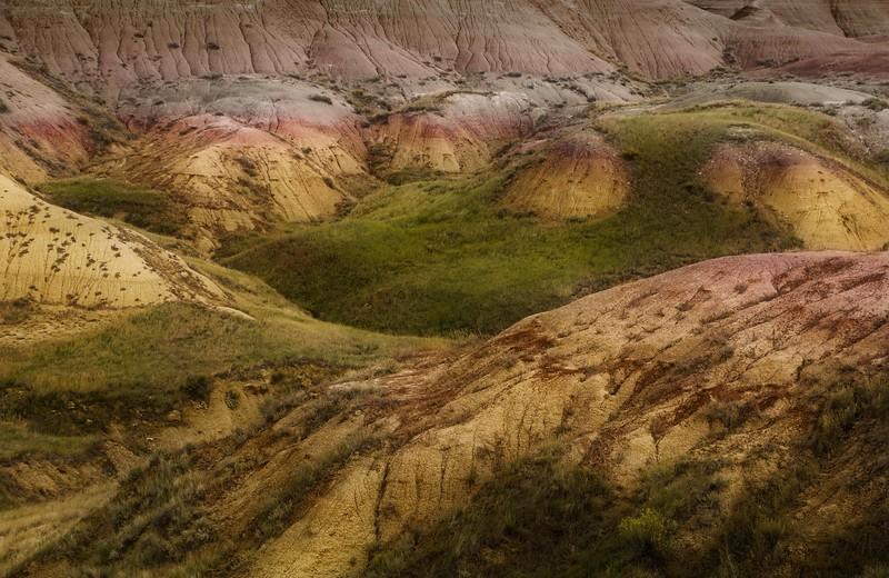 Surreal landscape at Badlands National Park.<br /> Photo © Cindy Clark