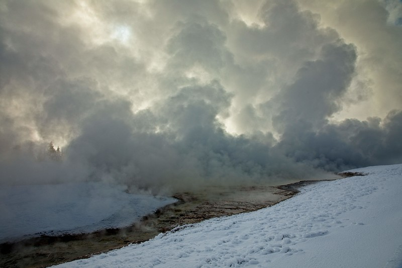 Steam rises along the Firehole River in Yellowstone.<br /> Photo © Carl Clark