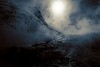 The sun provides backlit drama to the steam rising from Mammoth Hot Springs.<br /> Photo © Cindy Clark