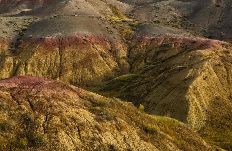 More far-out shapes & colors in Badlands National Park.<br /> Photo © Cindy Clark
