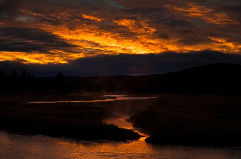 Early bird reward! This is sunrise over the Yellowstone River.<br /> Photo © Cindy Clark