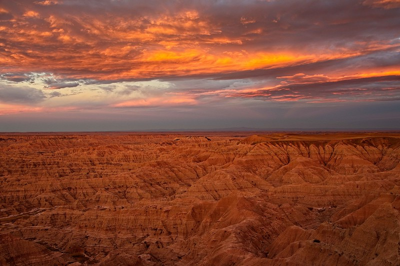 Color galore at sunrise in the Badlands, South Dakota.<br /> Photo © Carl Clark