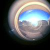 Looking east in the morning at the world through a peep hole in Denver - 1977.