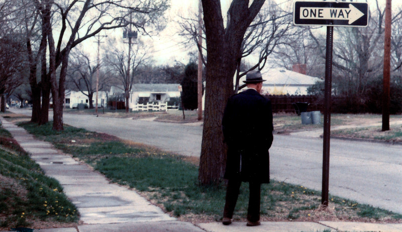 On the corner of Mt. Vernon & Topeka in Wichita Kansas in 1981.<br /> <br /> This song was popular about the time I saw this guy and I had the Exacta with me...<br /> <br /> See the lonely man there on the corner,<br /> What he's waiting for, I don't know,<br /> But he waits everyday now.<br /> He's just waiting for something to show.<br /> <br /> And nobody knows him,<br /> And nobody cares,<br /> 'Cos there's no hiding place,<br /> There's no hiding place - for you.<br /> <br /> --Phil Collins