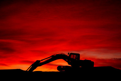 Sunset with track hoe, Springfield, Missouri. About 2002.