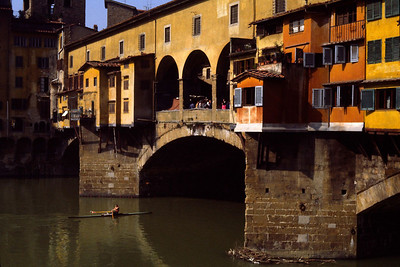 Rower under the Ponte Vecchio. Florence, Italy, 1983.