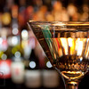 Bokeh at the Bar - A single glass in view befoe the shelves of bottles behind