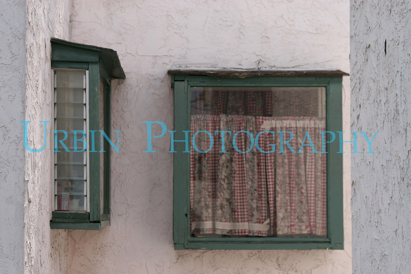 A pair of green box windows.