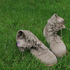 A pair of US Army boots that look tired.