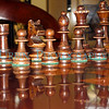 Chess pieces and their reflection.