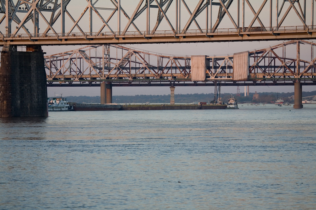 Four fireworks barges on the up river side of the 2nd street bridge.