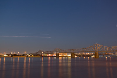 The scene at dusk: Ohio River at Louisville, 8 barges loaded with 60 tons of fireworks shells, and the Second Street bridge wired for ground display.