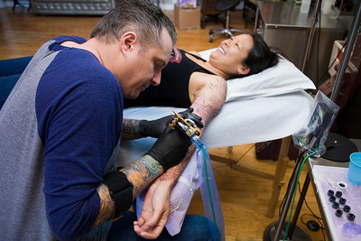 Ting Su getting a Tattoo from Shawn Barber