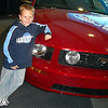 Josh as excited to see a real mustang in person!  That's my boy!  I wish I still had my '92 Calypso Green 5 speed.  He doesn't even remember it.