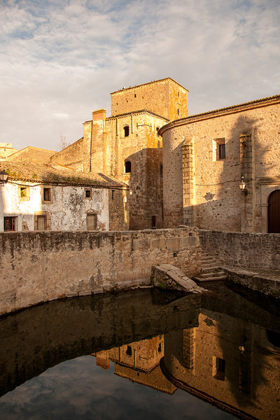 The combination of the setting sun and the mirror effect of the 45 foot deep ancient well form a compelling compostion in this shot of ancient walled city of Trujillo Spain.<br /> Again thank you for all of your comments and feedback..