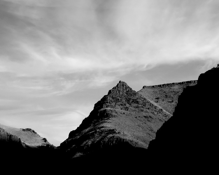 John Day Park out in eastern Oregon just before Picture Canyon on a beautiful day...As the sun was setting the shadows were heavy in the b&w version you can concentrate on the shapes and the sky.