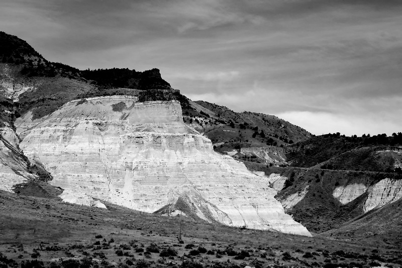 """The green of these cliffs comes out much better in BW creating a vivid contrast to the surrounding area..taken at John Day last weekend.<br /> Thanks for all your lovely comments.<br /> Last night we saw the premier of """"Light of Mine"""" about a photographer that looses his eyesight to a hereditary disease..filmed around Oregon and Yellowstone...very interesting..and moving..<br /> <br /> check it out if it comes to a city near you.."""