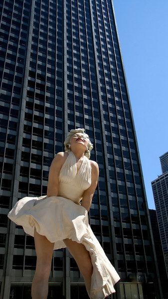 "The new Marilyn Monroe statue in Chicago has crowds gathered around her almost constantly. This is located in front of the Wrigley building right next to the Chicago River. Apparently Marilyn will be coming down next spring, she is 26 feet tall.<br /> For more pics of Chicago check out <a href=""http://www.goldenoakphotography.com/Architecture/Chicago-Architecture/"">http://www.goldenoakphotography.com/Architecture/Chicago-Architecture/</a>"