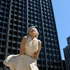 """The new Marilyn Monroe statue in Chicago has crowds gathered around her almost constantly. This is located in front of the Wrigley building right next to the Chicago River. Apparently Marilyn will be coming down next spring, she is 26 feet tall.<br /> For more pics of Chicago check out <a href=""""http://www.goldenoakphotography.com/Architecture/Chicago-Architecture/"""">http://www.goldenoakphotography.com/Architecture/Chicago-Architecture/</a>"""