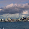 From across the bay Seattle with the puffy clouds behind..What a great city!