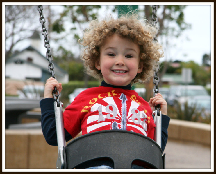"Love the happiness of Nolan's face while on the swing!<br /> He kept saying, ""Higher, Higher, Higher"" just as any 3 year old would..<br /> If we could only hold that childish gleefulness close to us for the rest of our lives?"