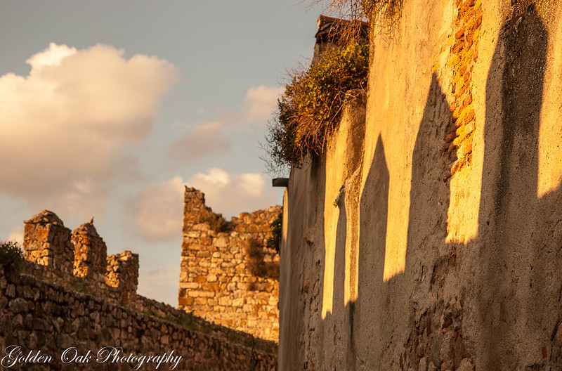 "Setting sun in ""Trujillo Ruins"", love the soft light and the shadows as the sun sets over the ancient walled town of Trujillo Spain.<br /> Walking the narrow lanes you can almost feel the battles and wars that were fought here."