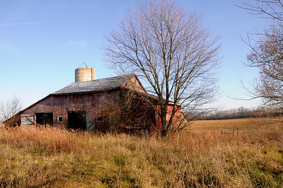 11/30/12  Once Upon a Time  This old barn was once used to store hay, and the silo stored silage for a beef operation, but no longer.  The farm has gone to row crops of wheat, soybeans and corn.  No telling how long the barn has been neglected, but it still stands as a testament to times gone by.