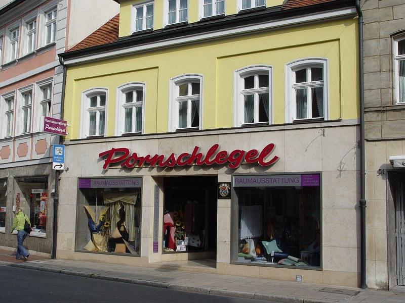 2005-09-14_06392 5. Tag - Bamberg - das 1. was ich sehe, als ich meinen Rucksack in meinem Zimmer gebunkert hatte, war auf der gegenüberliegenden Seite der Raumausstatter 'Pornschlegel' Fifth day - Bamberg - the first thing I see after I left my backpack in my room and wanted to conquer the city was the interior decorator store named 'Pornschlegel' (porn sledge) across the street.