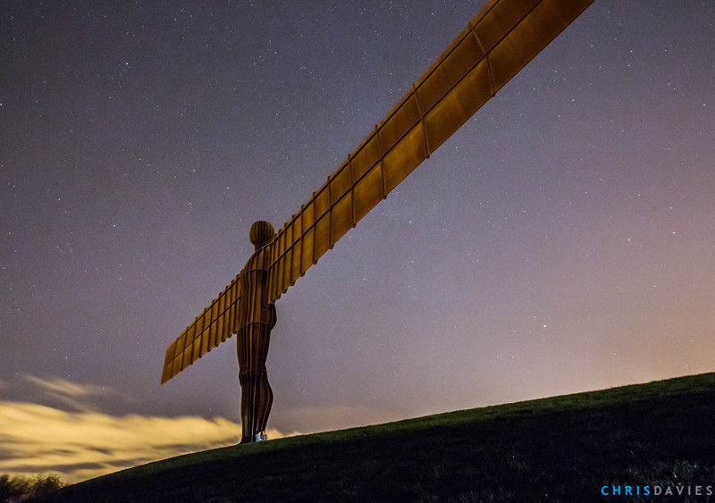 Under the wings of an Angel A night time shot of the beautiful Angel of the North sculpture in Gateshead near Newcastle, England. Look closely at the feet where a couple are taking a photo