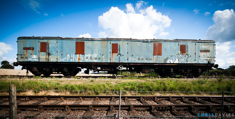 A graffiti'd carriage sits on the tracks at a disused railway near Northampton, UK