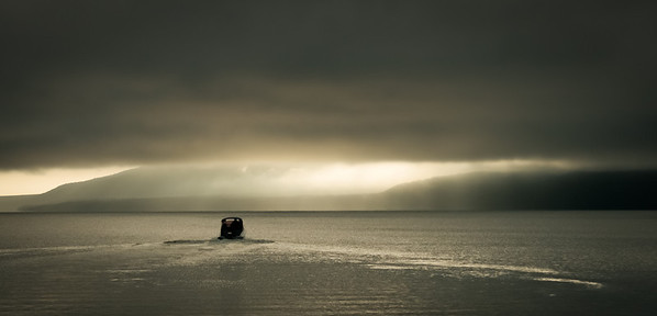 A boat ventures out onto Lake Rotorua in New Zealand