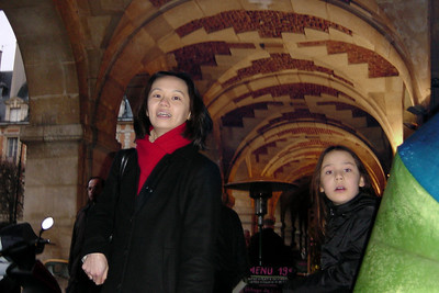Valerie and Charline stay under the arches