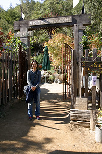 Valerie quickly checks out the neighboring garden and nursery before we depart
