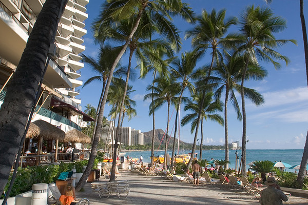 Valerie and I walk along the sand and then down Kalakaua Ave