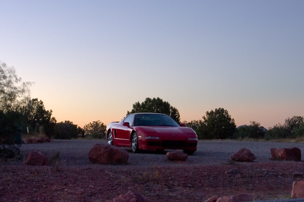 A warm glow is on the horizon behind my NSX